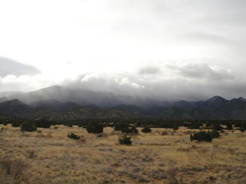 Ooh.  Look.  Clouds caught up on the Sandias.  Cannot bode well for us.