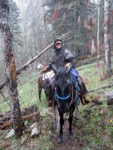Me, on the mustang Carson, with Lacey packing salt. Muddier and muddier.