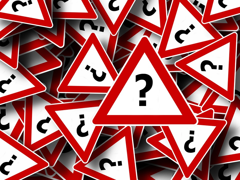 Question marks! https://pixabay.com/en/road-sign-attention-right-of-way-63983/